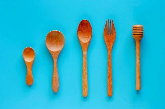 Colher madeira, garfo, e, dipper mel, ligado, experiência azul