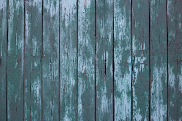 Colorido em cerca de madeira verde textura de pranchas de madeira verdes parede de celeiro antigo estilo rústico