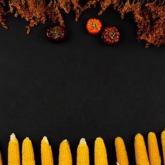 Comida de outono vista superior com fundo preto