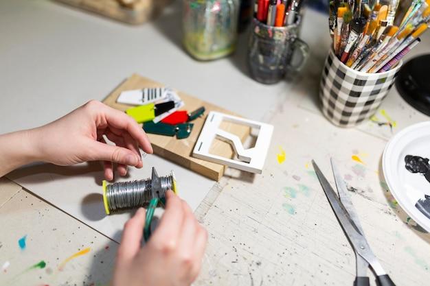 Composição de elementos de elaboração de trabalho artesanal