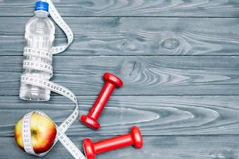 Composição de equipamentos de esporte e alimentação saudável