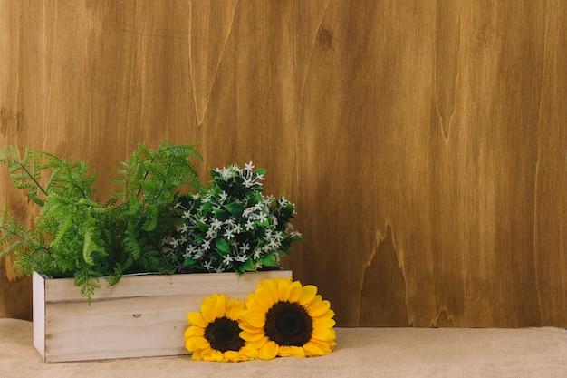 Composição de flores com girassóis