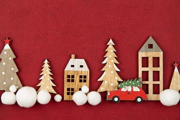 Composição de natal com casas de madeira de brinquedo