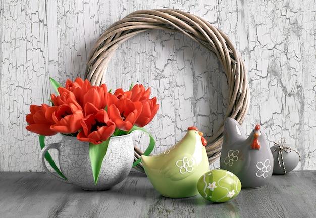 Composição de páscoa com guirlanda de madeira, tulipas vermelhas, galinhas de cerâmica e ovos pintados