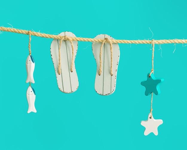 Composição de verão com itens marinhos e sapatos de praia pendurados em um barbante