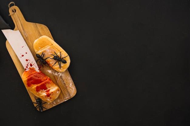 Composição do dia das bruxas com decoração de pão