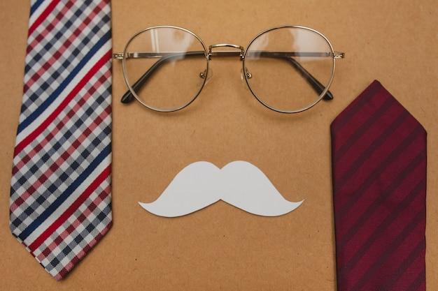 Composição do dia dos pais com bigode, óculos e gravatas
