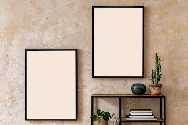 Composição moderna do interior da sala de estar com molduras pretas, estante de livros, planta e acessórios pessoais. decoração elegante. parede de grunge. conceito wabi sabi ..