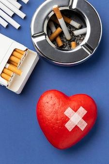 Composição plana de elementos do dia sem tabaco