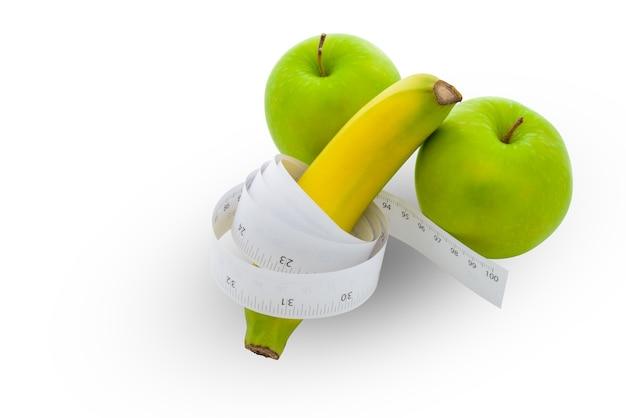 Comprimento de banana e maçã conceito genital masculino