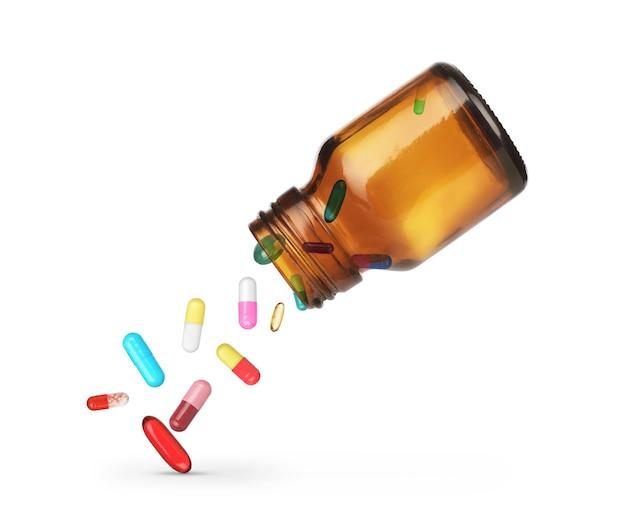 Comprimidos caindo de um frasco em um fundo branco