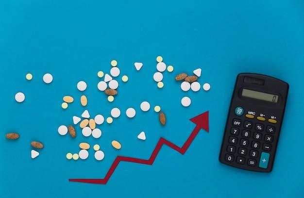 Comprimidos com calculadora, seta tendendo para cima em um azul