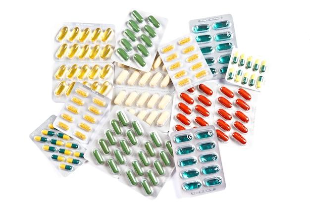 Comprimidos e cápsulas coloridas variadas