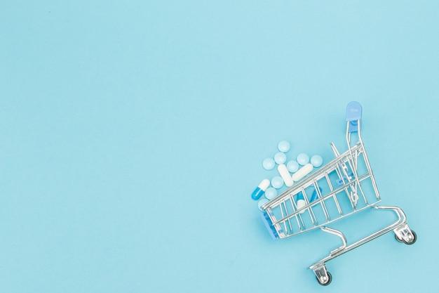 Comprimidos e carrinho de compras