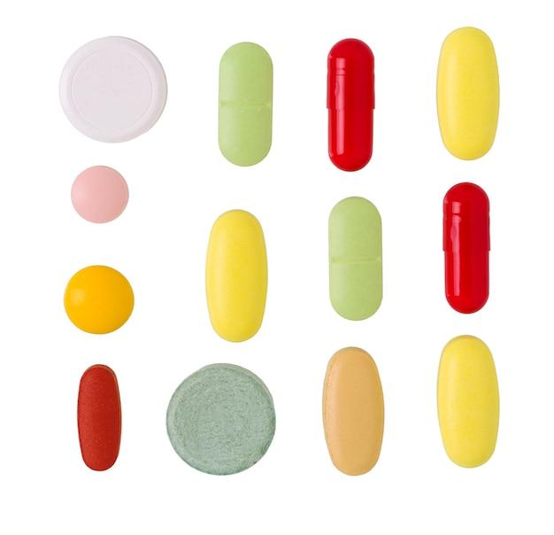 Comprimidos e pílulas. pilha de comprimidos, cápsulas e comprimidos médicos coloridos.