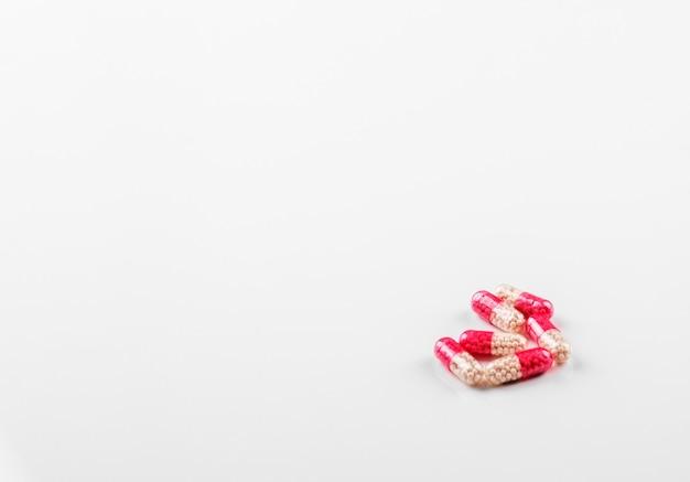 Comprimidos em cápsulas