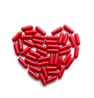 Comprimidos longos vermelhos em forma de coração