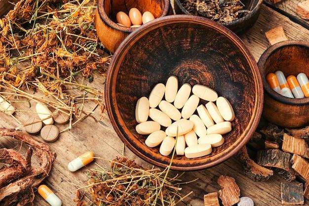 Comprimidos médicos com ervas curativas