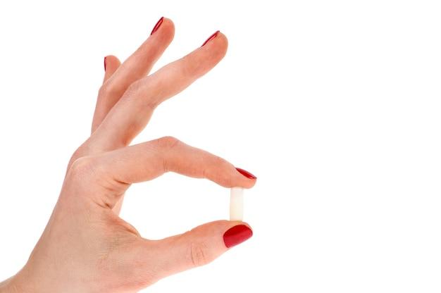 Comprimidos na mão de mulher