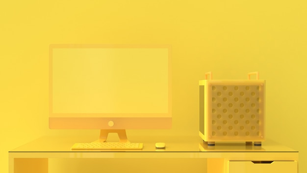 Computador amarelo na mesa de trabalho.