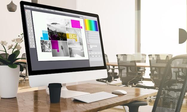 Computador com tela de software de design de composição em um escritório comercial moderno