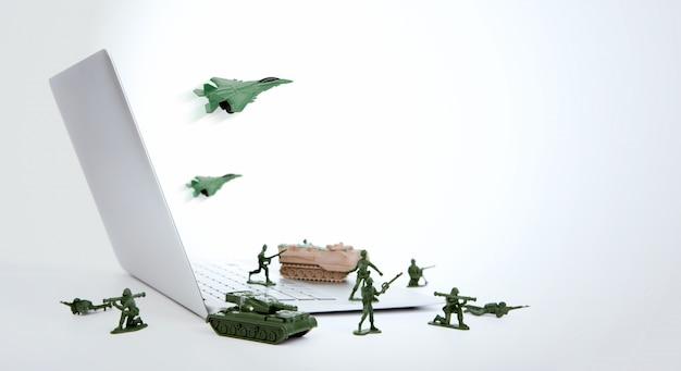 Computador conceito de segurança: soldados, tanque, avião está guardando um