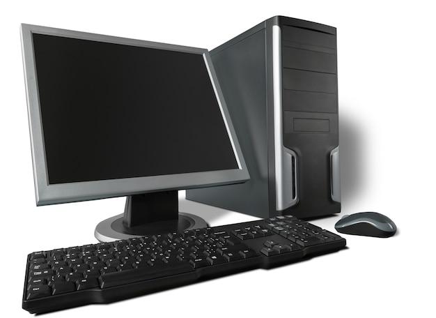 Computador desktop e teclado em segundo plano