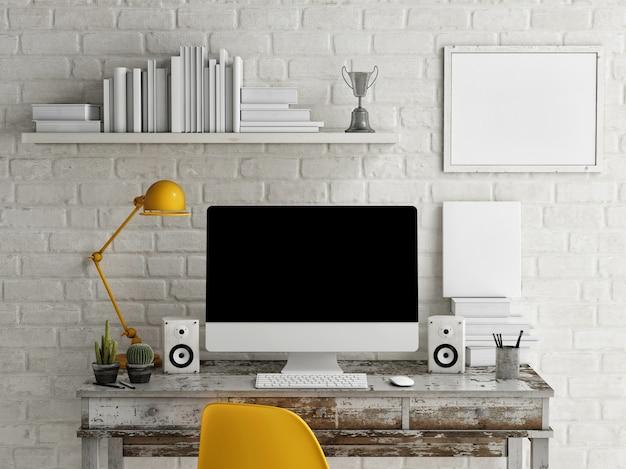 Computador e pôster de maquete do espaço de trabalho.
