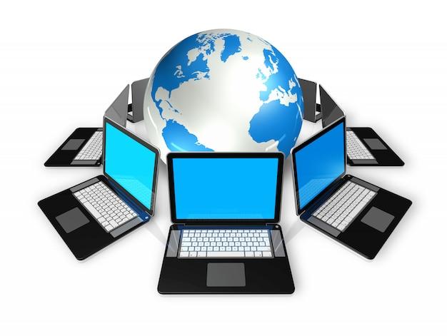 Computadores portáteis em torno de um globo do mundo