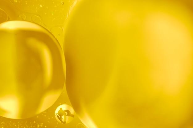 Conceito abstrato de bolhas grandes douradas