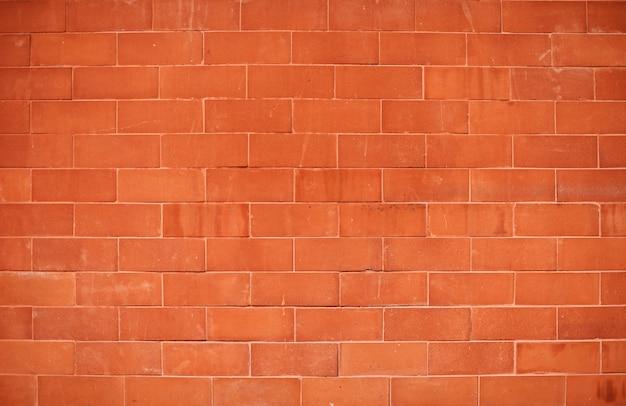 Conceito da textura do papel de parede do fundo da parede de tijolo