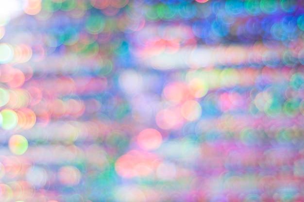 Conceito de ano novo, plano de fundo de natal. bokeh multicolorido em tons de rosa e azul.