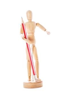 Conceito de arte, figura de madeira para modelagem de poses humanas e lápis