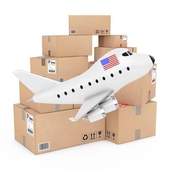 Conceito de carga aérea. desenhos animados toy jet airplane com bandeira dos eua perto de caixas de mercadorias em um fundo branco. renderização 3d.