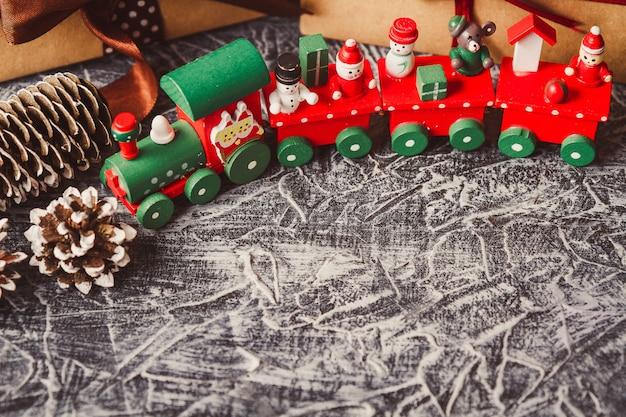 Conceito de cartão de natal com decoração de férias em fundo cinza de concreto
