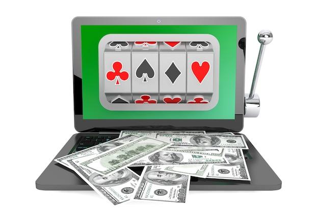 Conceito de casino online. máquina caça-níqueis dentro do laptop com dólares em um fundo branco