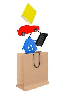 Conceito de compra. livro, laptop, carro e casa caem em um saco de papel em um fundo branco