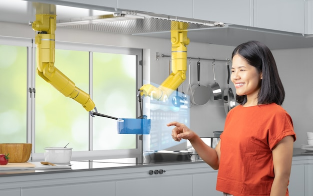 Conceito de cozinha inteligente com robô chef de renderização em 3d cozinhando na cozinha com controle de mulher asiática
