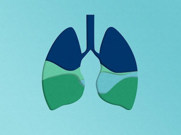 Conceito de ecologia na arte finala de corte de papel. pulmões com campos verdes. poluição do ar, asma, problemas de pneumonia