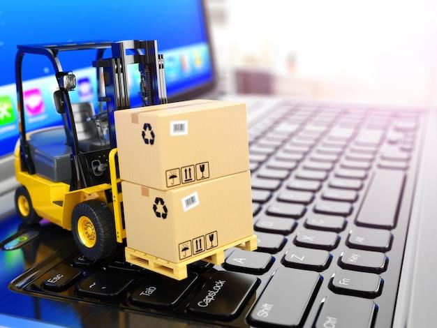 Conceito de entrega, envio ou logística. empilhadeira no teclado do laptop. 3d