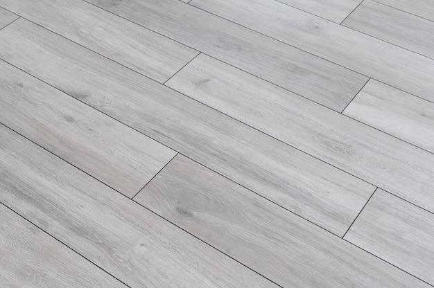 Conceito de fundo de textura de piso laminado cinza de acabamento de redecoração de casas e apartamentos em