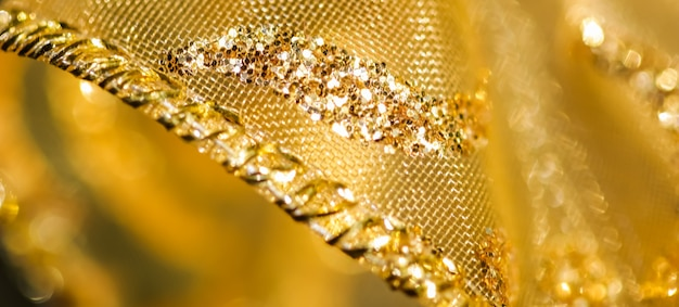 Conceito de fundo desfocado borrão abstrato dourado para véspera de ano novo, natal e boas festas