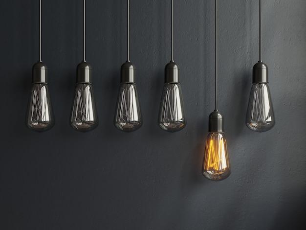 Conceito de ideia de lâmpada luz brilhante no preto