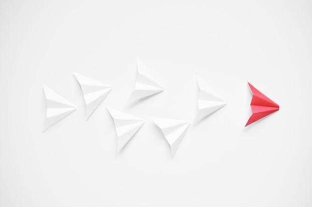 Conceito de liderança. aviões de papel vermelho principais brancos
