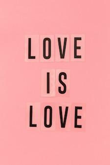 Conceito de orgulho gay amor é amor fundo rosa