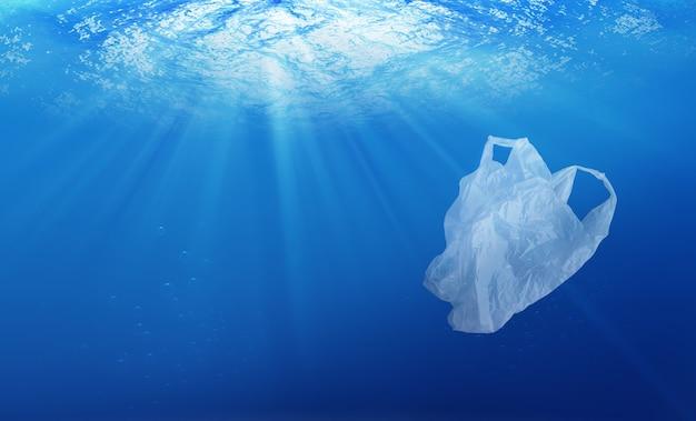 Conceito de proteção ambiental. poluição do saco de plástico no oceano