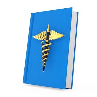 Conceito de publicação médica. caneta-tinteiro dourado como símbolo de caduceu médico ouro sobre o livro médico azul sobre um fundo branco. renderização 3d