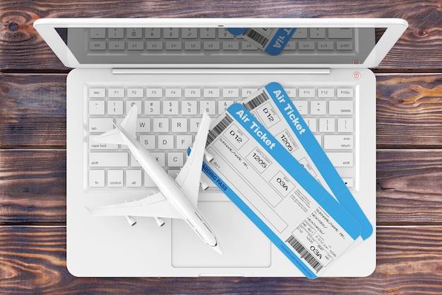 Conceito de reserva online. bilhetes de embarque de avião com avião a jato sobre laptop em uma mesa de madeira closeup extrema. renderização 3d