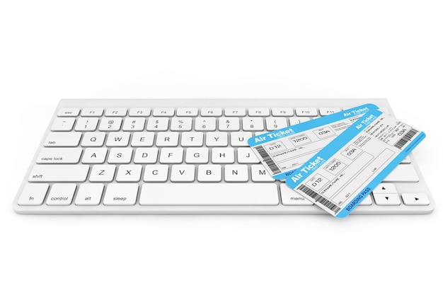 Conceito de reserva online. teclado de computador com passagens aéreas em um fundo branco