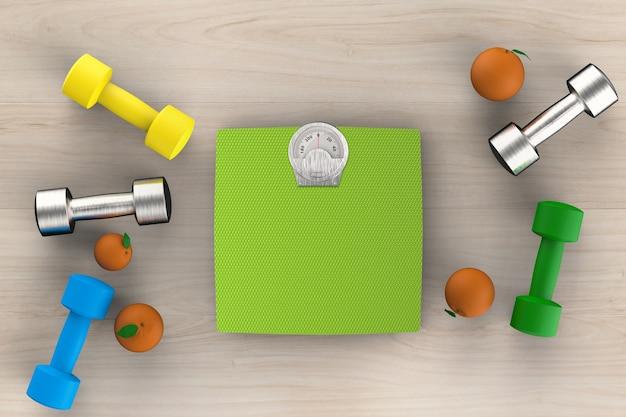 Conceito de saúde com balanças de peso com halteres e laranjas